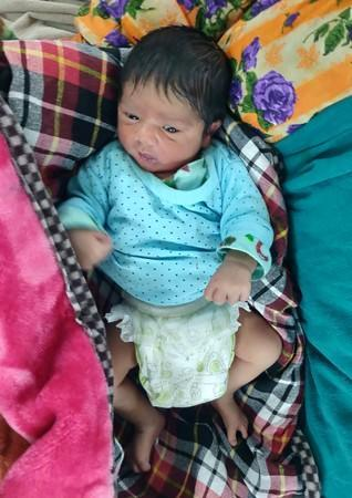 A baby boy is pictured in a hospital two days after his birth for which his parents travelled hours from south Kashmir's Kokernag to reach a Srinagar hospital