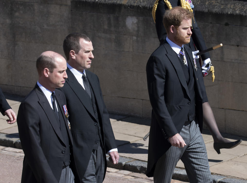 WINDSOR, ENGLAND - APRIL 17: Prince William, Duke of Cambridge, Peter Phillips and Prince Harry during the funeral of Prince Philip, Duke of Edinburgh on April 17, 2021 in Windsor, England. Prince Philip of Greece and Denmark was born 10 June 1921, in Greece. He served in the British Royal Navy and fought in WWII. He married the then Princess Elizabeth on 20 November 1947 and was created Duke of Edinburgh, Earl of Merioneth, and Baron Greenwich by King VI. He served as Prince Consort to Queen Elizabeth II until his death on April 9 2021, months short of his 100th birthday. His funeral takes place today at Windsor Castle with only 30 guests invited due to Coronavirus pandemic restrictions. (Photo by Mark Cuthbert-Pool/UK Press via Getty Images)