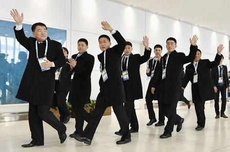 North Korean athletes and officials set to take part in the upcoming Asian Winter Games arrive at the New Chitose Airport in Chitose, Hokkaido