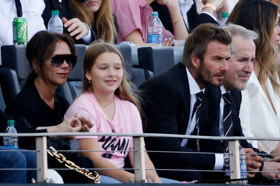 (L-R) Victoria Beckham, Harper Beckham and David Beckham. (Photo: Cliff Hawkins/Getty Images)