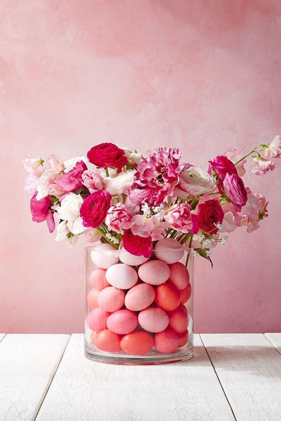 """<p>Dye some ombre eggs and arrange them in a clear glass vase. Then match the colors of the eggs with a nice bouquet of fresh flowers for an explosion of color. </p><p><strong><a class=""""link rapid-noclick-resp"""" href=""""https://www.amazon.com/Chefmaster-Liqua-gel-Coloring-Liquid-Fondant/dp/B07M6R724S/ref=sr_1_2?crid=2U078VYR4VKR5&keywords=easter+egg+dye&qid=1581611178&sprefix=easter+egg+dy%2Caps%2C155&sr=8-2&tag=syn-yahoo-20&ascsubtag=%5Bartid%7C10070.g.1751%5Bsrc%7Cyahoo-us"""" rel=""""nofollow noopener"""" target=""""_blank"""" data-ylk=""""slk:SHOP EASTER EGG DYE"""">SHOP EASTER EGG DYE</a></strong><br> </p>"""