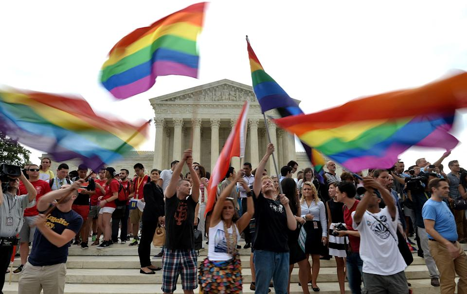 (FILES) In this file photo taken on June 26, 2015, people celebrate outside the Supreme Court in Washington, DC. The court ruled that same-sex marriage is a nationwide right. - The court on June 17, 2021, unanimously supported a Catholic adoption agency's rejection of same-sex foster parents, in a case that underscored the court's commitment to religious freedom. (Photo by Mladen ANTONOV / AFP) (Photo by MLADEN ANTONOV/AFP via Getty Images) ORG XMIT: 0 ORIG FILE ID: AFP_9CF3GH.jpg