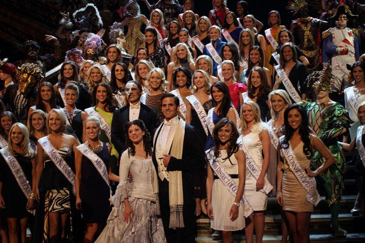 """LAS VEGAS, NV - JANUARY 06:  The Phantom of the Opera cast members Anthony Crivello, Kristi Holden and Andrew Ragone join the 2012 Miss America  Pageant contestants onstage after a performance of """"Phantom of the Opera"""" at the Venetian Resort and Casino on January 6, 2012 in Las Vegas, Nevada.  (Photo by Marcel Thomas/FilmMagic)"""