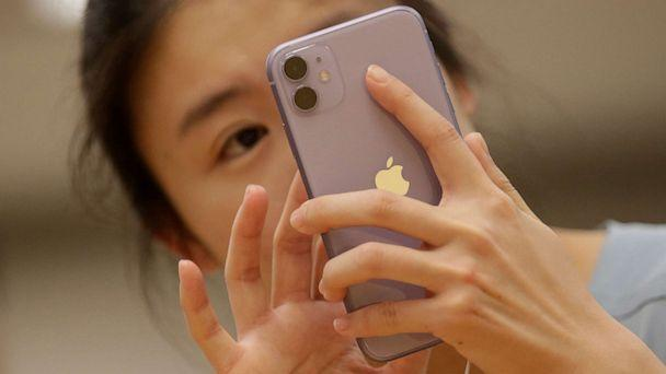 PHOTO: A customer tests Apple's iPhone 11 after it went on sale at the Apple Store in Beijing, China, Sept. 20, 2019. (Jason Lee/Reuters, File)