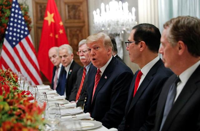 U.S. President Donald Trump, U.S. President Donald Trump's national security adviser John Bolton, U.S. Treasury Secretary Steven Mnuchin attend a working dinner with Chinese President Xi Jinping after the G20 leaders summit in Buenos Aires, Argentina December 1, 2018. REUTERS/Kevin Lamarque