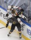 Chicago Blackhawks' Duncan Keith (2) is checked by Vegas Golden Knights' William Carrier (28) during the second period in Game 1 of an NHL hockey Stanley Cup first-round playoff series, Tuesday, Aug. 11, 2020, in Edmonton, Alberta. (Jason Franson/The Canadian Press via AP)
