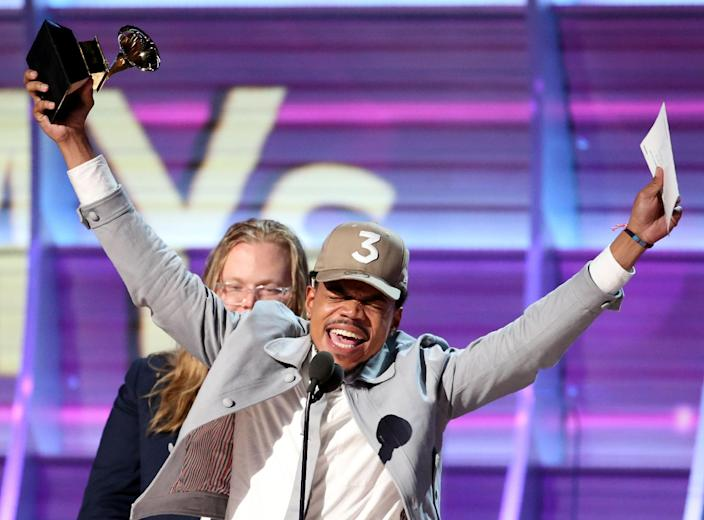 Image: Chance the Rapper celebrates as he accepts the Grammy for Best Rap Album for