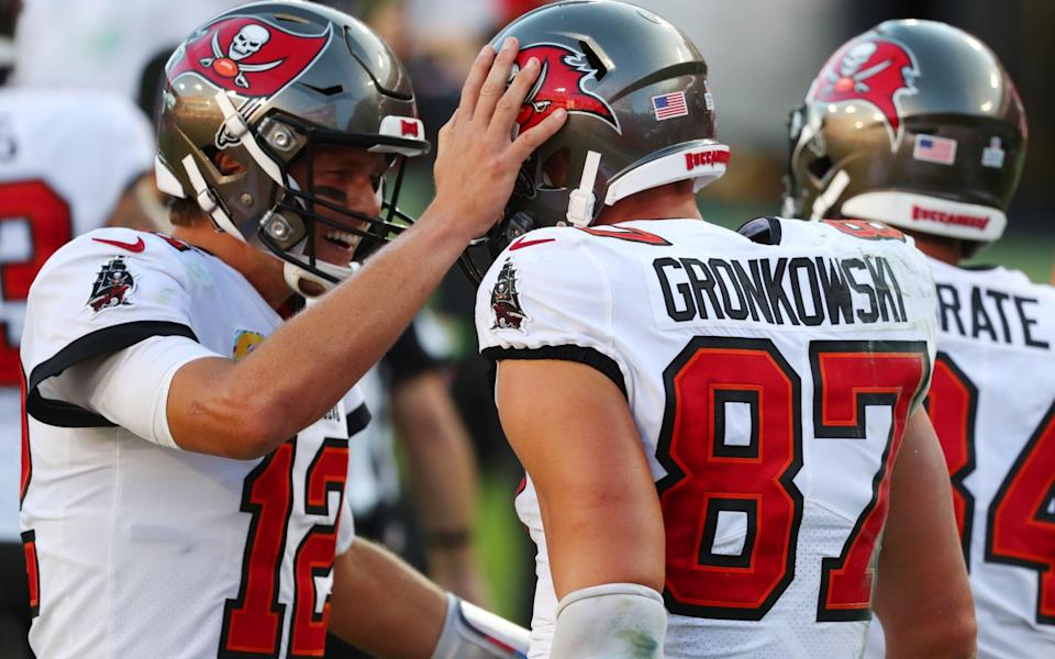 Tampa Bay Buccaneers tight end Rob Gronkowski (87) celebrates with quarterback Tom Brady (12) after scoring a touchdown against the Green Bay Packers during the second quarter of a NFL game at Raymond James Stadium. - Kim Klement-USA TODAY Sports