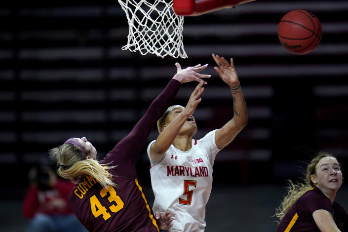 Maryland forward Alaysia Styles (5) loses the ball while going up for a shot against Minnesota forward Grace Cumming (43) during the second half of an NCAA college basketball game, Saturday, Feb. 20, 2021, in College Park, Md. Maryland won 94-62. (AP Photo/Julio Cortez)