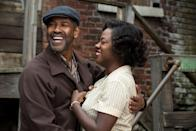 """As the resilient yet quietly aching Rose Maxson in <em>Fences,</em> Davis delivered a performance that was profoundly moving and impossible to ignore. First in the 2010 Broadway revival of August Wilson's Pulitzer Prize–winning play and subsequently in Denzel Washington's 2016 film adaptation, Davis anchors the film opposite Washington as Troy Maxon's long-suffering wife, who has steadfastly stood by her charismatic but selfish husband. When Rose finally gets <a href=""""https://www.youtube.com/watch?v=fb7xsdtiFNQ"""" rel=""""nofollow noopener"""" target=""""_blank"""" data-ylk=""""slk:to unleash and unload"""" class=""""link rapid-noclick-resp"""">to unleash and unload</a> 18 years worth of anguish onto Troy, Davis taps into the pain of a woman scorned so viscerally and deeply that it won her <a href=""""https://www.youtube.com/watch?v=RMNIMD9E94k"""" rel=""""nofollow noopener"""" target=""""_blank"""" data-ylk=""""slk:a second Tony"""" class=""""link rapid-noclick-resp"""">a second Tony</a> <em>and</em> <a href=""""https://www.youtube.com/watch?v=xbo9GVmv87Y"""" rel=""""nofollow noopener"""" target=""""_blank"""" data-ylk=""""slk:her first Oscar"""" class=""""link rapid-noclick-resp"""">her first Oscar</a> for best supporting actress."""
