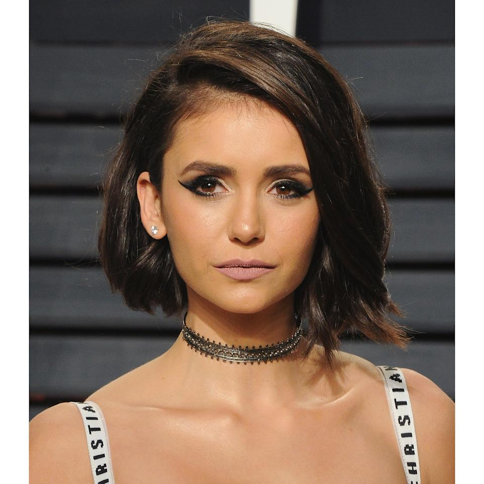 """<p><a rel=""""nofollow"""" href=""""http://www.allure.com/story/nina-dobrev-cut-her-hair?mbid=synd_yahoobeauty"""">Nina Dobrev</a> also debuted a parted bob hairstyle this year, but she added a bit of edge by leaving her textured waves slightly longer in the front. To master this look, Sparks likes to use three different sized hair curling wands followed by a bit of texture spray to lock the curls in.</p>"""