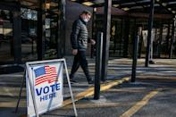 A voter leaves a polling station at the Zion Baptist Church in Marietta, Georgia