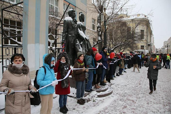"span class=""caption""Women form a human chain on Feb. 14 in central Moscow to support jailed opposition leader Alexei Navalny, his wife Yulia Navalnaya and other political prisoners. /span span class=""attribution""a class="