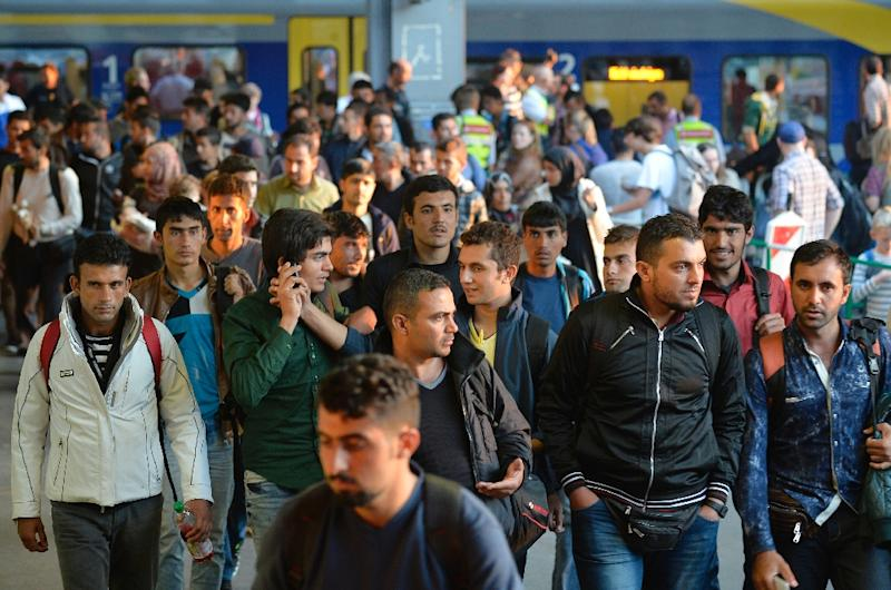 Migrants arrive at the railway station in Munich, southern Germany, on September 12, 2015 (AFP Photo/Philipp Guelland )