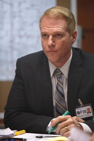 """This image released by FX shows Noah Emmerich as FBI Agent Stan Beeman in a scene from the second season of """"The Americans."""" The second season of the series premieres on Feb. 26, 2014 at 10 p.m. EST. (AP Photo/FX, Craig Blankenhorn)"""