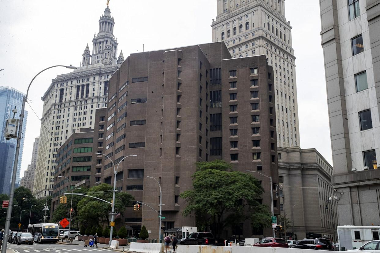 """FILE - This Aug. 13, 2019, file photo, shows the Metropolitan Correctional Center in New York. Suicide is such a constant concern at federal lockups such as the Metropolitan Correctional Center's Special Housing Unit that guards keep ready access to """"the stick,"""" a wooden pole with a sharpened blade at the end that's used to cut down inmates if they try to hang themselves with bedsheets, which is how Jeffrey Epstein is believed to have died. (AP Photo/Mary Altaffer, File)"""