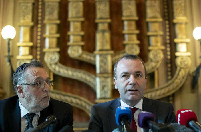 Chairman of the European People's Party (EPP) Group in the European Parliament Manfred Weber and President of the Federation of Jewish Religious Communities of Hungary (Mazsihisz) Andras Heisler, left, attends a press conference in the Dohany Street Synagogue in Budapest, Hungary, Tuesday, March 12, 2019. Weber said that a meeting with Hungary's prime minister has not resolved the issues that could lead to the expulsion of Hungary's Fidesz party from the bloc. (Balazs Mohai/MTI via AP)