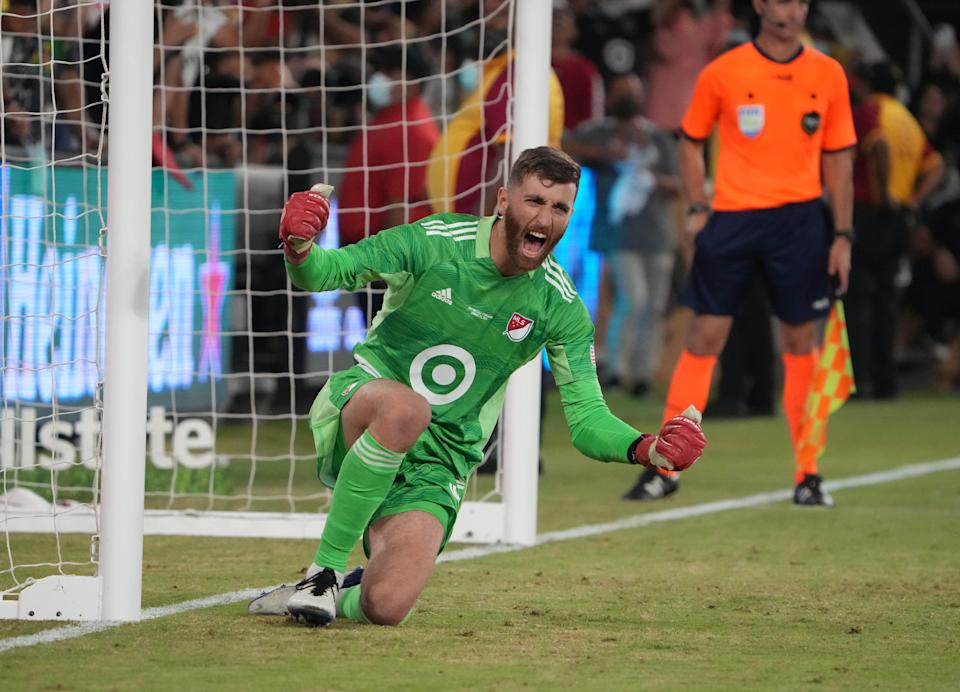Matt Turner celebrates after making a save during the penalty kick shootout during the MLS All-Star game at Banc of California Stadium.