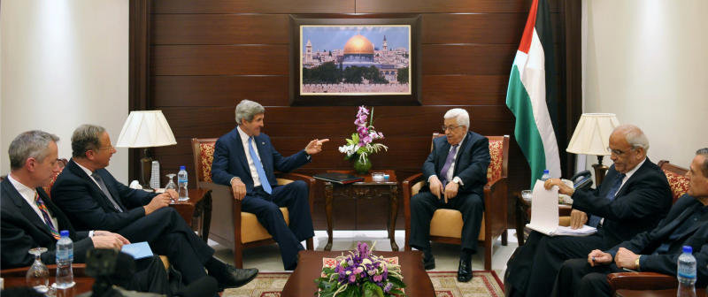 U.S. Secretary of State John Kerry, center left, meets with Palestinian President Mahmoud Abbas, center right, on Friday, July 19, 2013 in the West Bank city of Ramallah. U.S. Secretary of State John Kerry stepped up his drive to get Israelis and Palestinians back to the negotiating table, meeting with the Palestinian president Friday as he sought to close a deep divide between the two sides over a formula for resuming peace talks after nearly five years.(AP Photo/Mandel Ngan, Pool)