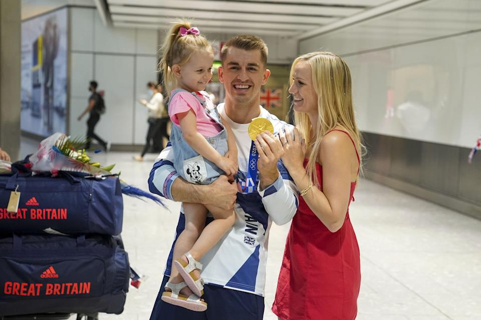 Olympic gymnast Max Whitlock, with his wife Leah and daughter Willow (Steve Parsons/PA) (PA Wire)
