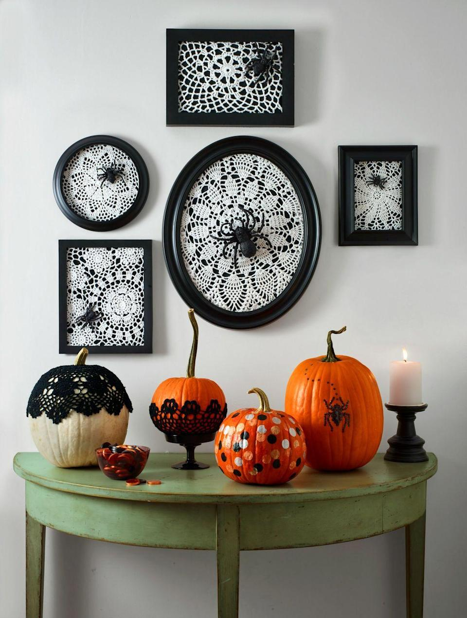 """<p>Frame a cotton doily and a plastic spider to honor Halloween's creepiest crawlies. </p><p><strong>What You'll Need:</strong> <a href=""""https://www.amazon.com/Silver-Embossed-Round-Cake-Board/dp/B079VGRP1B/ref=sr_1_5?dchild=1&keywords=doily&qid=1594917784&refinements=p_n_srvg_2947266011%3A3254098011&rnid=2947266011&sr=8-5&tag=syn-yahoo-20&ascsubtag=%5Bartid%7C10070.g.1279%5Bsrc%7Cyahoo-us"""" rel=""""nofollow noopener"""" target=""""_blank"""" data-ylk=""""slk:Doilies"""" class=""""link rapid-noclick-resp"""">Doilies</a> ($6, Amazon); <a href=""""https://www.amazon.com/U-S-Toy-Painted-Spiders-Package/dp/B00DEZQ5IE/ref=sr_1_10?dchild=1&keywords=plastic+spider&qid=1594918182&sr=8-10&tag=syn-yahoo-20&ascsubtag=%5Bartid%7C10070.g.1279%5Bsrc%7Cyahoo-us"""" rel=""""nofollow noopener"""" target=""""_blank"""" data-ylk=""""slk:plastic spiders"""" class=""""link rapid-noclick-resp"""">plastic spiders </a>($3, Amazon)</p>"""