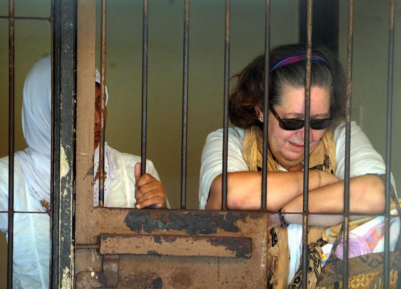 Lindsay June Sandiford (R) of Britain reacts inside a holding cell after her trial at a court in Denpasar on the Indonesian resort island of Bali, November 28, 2012