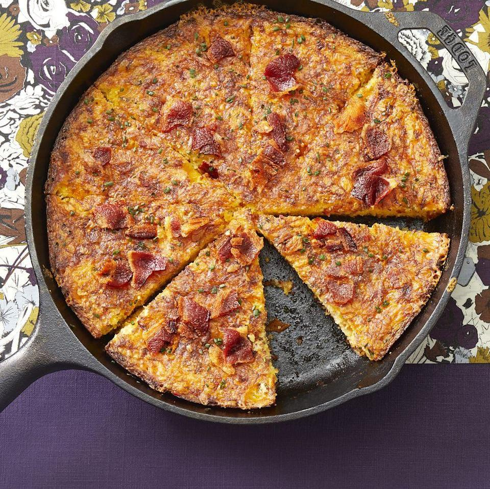 """<p>Turn cornbread into the main attraction! This dish has bacon and cheddar mixed in for a delicious taste.</p><p><strong><a href=""""https://www.thepioneerwoman.com/food-cooking/recipes/a34776419/bacon-cheddar-skillet-cornbread/"""" rel=""""nofollow noopener"""" target=""""_blank"""" data-ylk=""""slk:Get the recipe."""" class=""""link rapid-noclick-resp"""">Get the recipe.</a></strong></p><p><strong><a class=""""link rapid-noclick-resp"""" href=""""https://go.redirectingat.com?id=74968X1596630&url=https%3A%2F%2Fwww.walmart.com%2Fbrowse%2Fhome%2Fcast-iron-cookware%2Fthe-pioneer-woman%2F4044_623679_8140341_1241961%2FYnJhbmQ6VGhlIFBpb25lZXIgV29tYW4ie&sref=https%3A%2F%2Fwww.thepioneerwoman.com%2Ffood-cooking%2Fmeals-menus%2Fg35049189%2Fsuper-bowl-food-recipes%2F"""" rel=""""nofollow noopener"""" target=""""_blank"""" data-ylk=""""slk:SHOP CAST-IRON COOKWARE"""">SHOP CAST-IRON COOKWARE</a><br></strong></p>"""