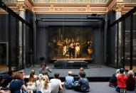 Children look at Rembrandt's famed Night Watch at Rijksmuseum in Amsterdam