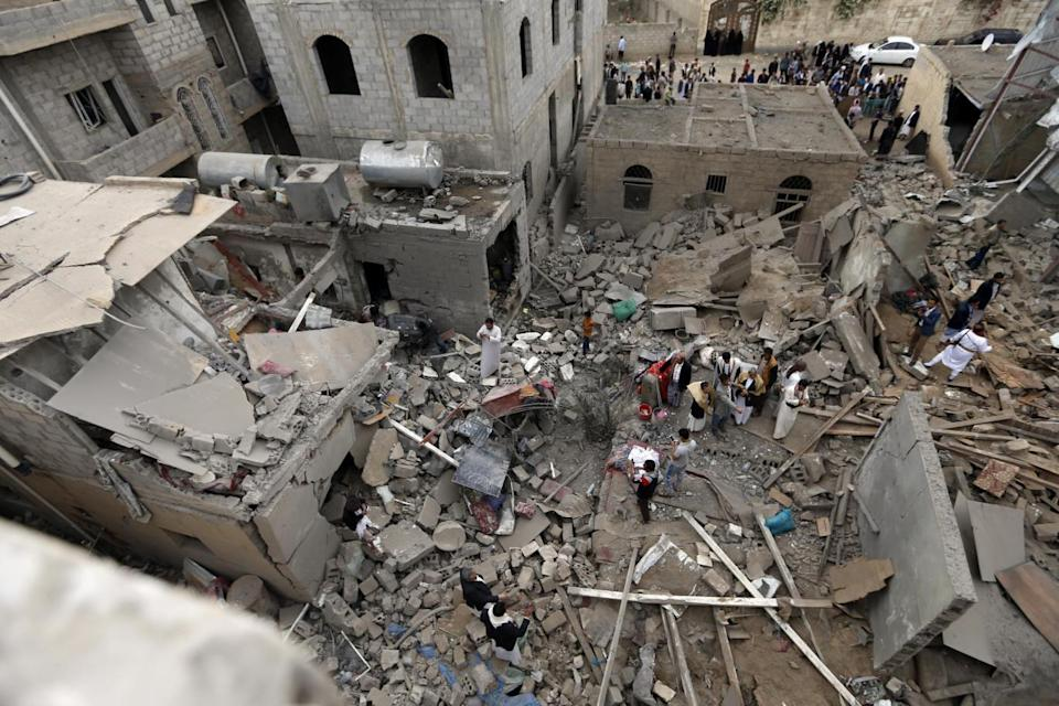 Yemenis stand on the rubble of houses destroyed in a suspected Saudi-led coalition air strike in Sanaa on June 9, 2017. Four civilians, including two teenagers, died 'in a strike by the coalition that targeted a civilian house behind the presidential palace in the south of the capital', a medical source said (AFP)