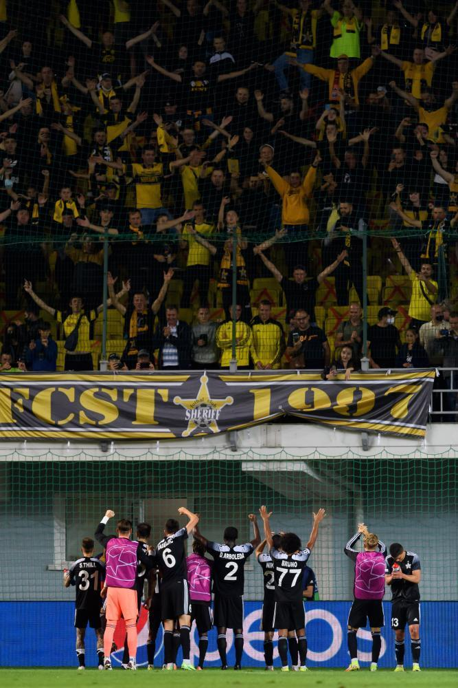 Sheriff Tiraspol players celebrate with the fans after beating Shakhtar Donetsk