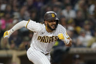 San Diego Padres' Fernando Tatis Jr. runs as he lines out during the sixth inning of a baseball game against the Atlanta Braves, Friday, Sept. 24, 2021, in San Diego. (AP Photo/Gregory Bull)