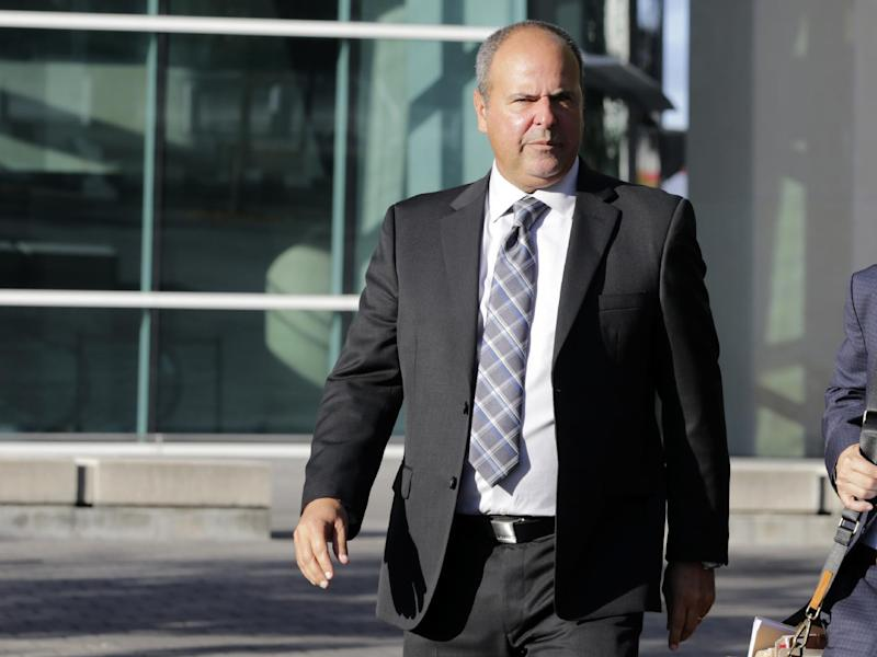 FILE - In this Feb. 1, 2017, file photo, sports agent Bartolo Hernandez leaves federal court in Miami. Closing arguments are set for Tuesday, March 14, 2017, in the Miami trial of Hernandez and trainer Julio Estrada accused of smuggling Cuban baseball players into the United States. Both are facing conspiracy and alien smuggling charges. (AP Photo/Lynne Sladky, File)