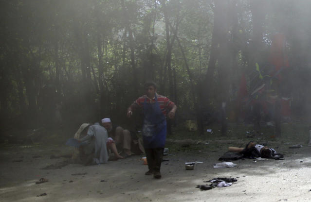 <p>Victims in double explosions, lie on the ground in Kabul, Afghanistan, April 30, 2018. (Photo: Massoud Hossaini/AP) </p>