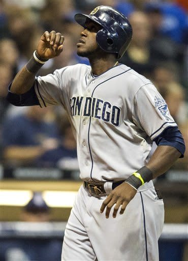 San Diego Padres' Cameron Maybin celebrates his two-run home run off of Milwaukee Brewers' Brandon Kintzler during the sixth inning of a baseball game, Wednesday, Oct. 3, 2012, in Milwaukee. (AP Photo/Tom Lynn)