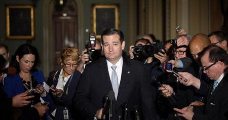 Reporters gather around U.S. Senator Cruz at the U.S. Capitol in Washington