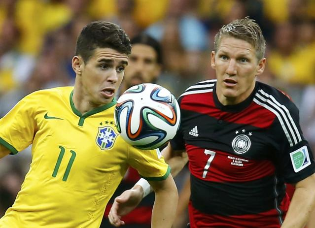Brazil's Oscar (L) fights for the ball with Germany's Bastian Schweinsteiger during their 2014 World Cup semi-finals at the Mineirao stadium in Belo Horizonte July 8, 2014. REUTERS/Kai Pfaffenbach (BRAZIL - Tags: SOCCER SPORT WORLD CUP)