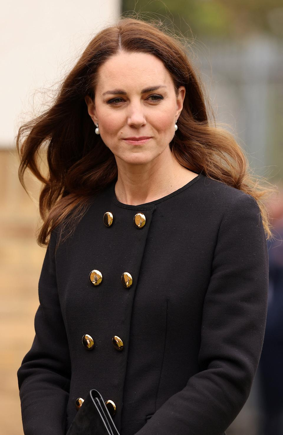 Britain's Catherine, Duchess of Cambridge, wearing black as a mark of respect following the death of Britain's Prince Philip, Duke of Edinburgh, meet air Cadets during their visit to 282 (East Ham) Squadron Air Training Corps in east London on April 21, 2021