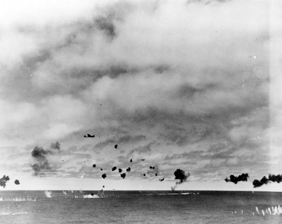 FILE - This June 4, 1942 file photo provided by the U.S. Navy shows Japanese Type 97 shipboard attack aircraft from the carrier Hiryu amid heavy anti-aircraft fire, during the torpedo attack on USS Yorktown (CV-5) in the mid-afternoon. Researchers scouring the world's oceans for sunken World War II ships are honing in on debris fields deep in the Pacific. A research vessel called the Petrel is launching underwater robots about halfway between the U.S. and Japan in search of warships from the Battle of Midway. (U.S. Navy via AP, File)