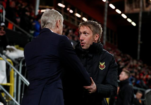 Soccer Football - Europa League Round of 32 First Leg - Ostersunds FK vs Arsenal - Jamtkraft Arena, Ostersund, Sweden - February 15, 2018 Arsenal manager Arsene Wenger and Ostersunds FK coach Graham Potter before the match Action Images via Reuters/Peter Cziborra