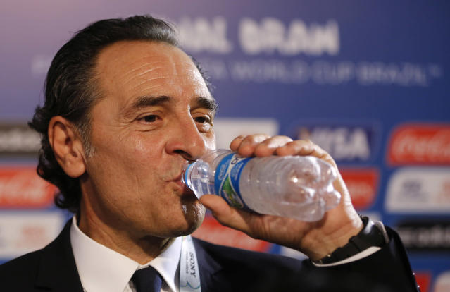 Italy head coach Cesare Prandelli drinks water after the draw ceremony for the 2014 soccer World Cup in Costa do Sauipe near Salvador, Brazil, Friday, Dec. 6, 2013. (AP Photo/Victor R. Caivano)