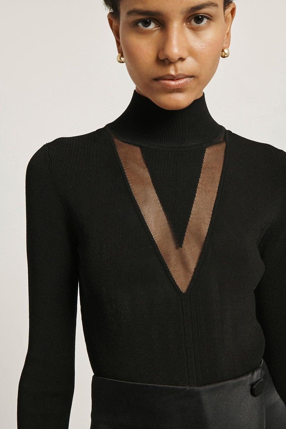 <p>This <span>Black Stretch Viscose Mock Neck Top</span> ($159, originally $795) will easily transition from daytime to evening.</p>