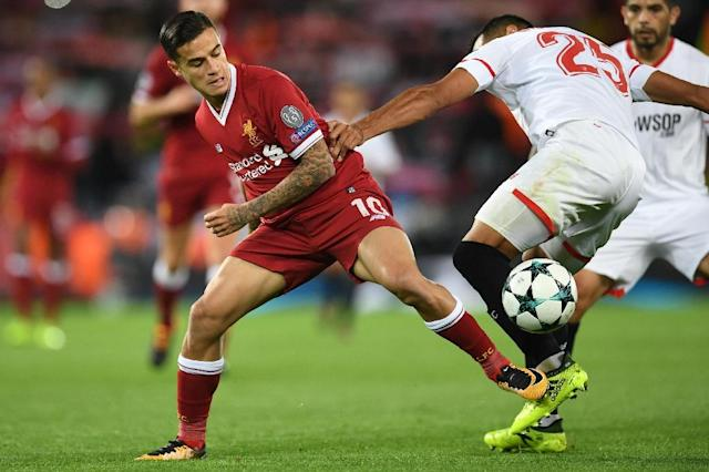 Liverpool midfielder Philippe Coutinho (L) managed 14 minutes in the Champions League against Sevilla. (AFP Photo/Paul ELLIS)