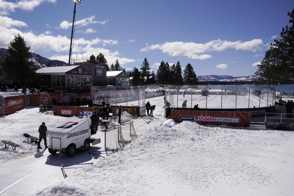 A Zamboni machine leaves the outdoor rink where the Vegas Golden Knights and Colorado Avalanche will play in the Outdoor Lake Tahoe NHL hockey game at Stateline, Nev., Saturday, Feb. 20, 2021. (AP Photo/Rich Pedroncelli)