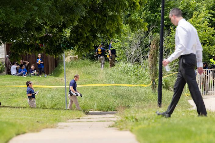 Dallas Police and members of the FBI investigate the scene close to where a toddler was found dead with multiple wounds on Saturday, May 15, 2021, in the Mountain Creek area of Dallas. (Juan Figueroa/The Dallas Morning News via AP)