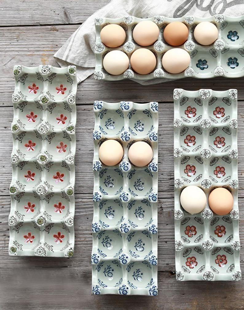 """<p><strong>Anikki Studio Ceramic Egg Holder</strong></p><p>etsy.com</p><p><strong>$63.00</strong></p><p><a href=""""https://go.redirectingat.com?id=74968X1596630&url=https%3A%2F%2Fwww.etsy.com%2Flisting%2F845199201%2Fcreative-ceramic-egg-trays-vintage&sref=https%3A%2F%2Fwww.redbookmag.com%2Fhome%2Fg35380342%2Fhow-to-organize-a-fridge%2F"""" rel=""""nofollow noopener"""" target=""""_blank"""" data-ylk=""""slk:BUY NOW"""" class=""""link rapid-noclick-resp"""">BUY NOW</a></p><p>Put your milk and eggs on a shelf, not the side door compartment—save that area for your condiments. If you don't have space on the same shelf because of other beverages that require that extra, you can put your eggs on the top shelf. </p>"""
