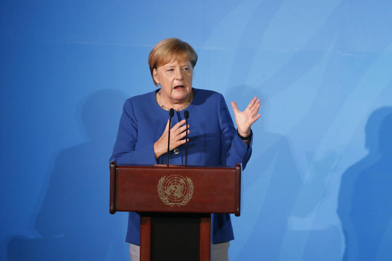 Germany's Chancellor Angela Merkel addresses the Climate Action Summit in the United Nations General Assembly, at U.N. headquarters, Monday, Sept. 23, 2019. (AP Photo/Jason DeCrow)