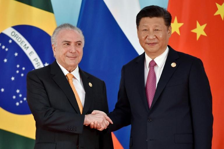 Chinese President Xi Jinping -- shown here with his Brazilian counterpart Michel Temer on September 4, 2017 in Xiamen -- is pouring more and more money into Latin America's biggest economy