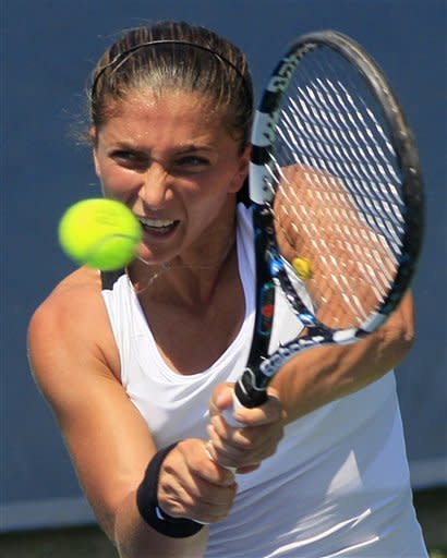 Sara Errani, from Italy, hits a backhand shot against Daniela Hantuchova, from Slovakia, during a match at the Western & Southern Open tennis tournament, Wednesday, Aug. 15, 2012, in Mason, Ohio. (AP Photo/Al Behrman)