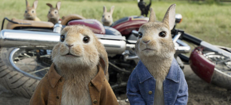 "FILE - This filei mage released by Columbia Pictures shows characters Benjamin, voiced by Colin Moody, left, and Peter Rabbit, voiced by James Corden and Cottontail in a scene from ""Peter Rabbit."" ""Peter Rabbit"" hopped to second place with $25 million, Universal Pictures estimates Sunday, Feb. 11, 2018. (Columbia Pictures/Sony via AP, Filr)"