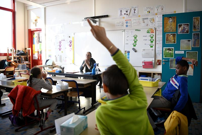 Pupils observing social distance rules listen to their teacher at the Saint Germain de Charonne school in Paris on May 14, 2020, as primary schools in France re-open this week and the country eases lockdown measures taken to curb the spread of the COVID-19. (Franck Fife/AFP via Getty Images)